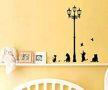 Наклейка на стену Черные кошки под уличными фонарями