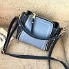 Маленькая женская синяя сумочка через плечо с декоративными змейками
