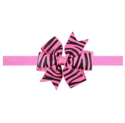 Розовая детская повязка с принтом зебры - размер универсальный (на резинке), бантик 8см