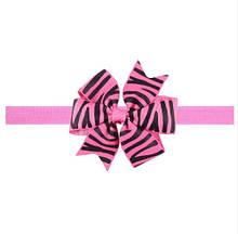 Рожева дитяча пов'язка з принтом зебри - розмір універсальний (на резинці), бантик 8см