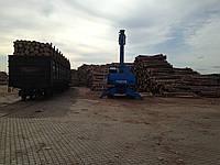Перевалка леса в контейнера