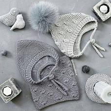 Свіжі новинки дитячих в'язаних шапок оптом вже у каталозі магазина 7км.