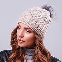 Стильна вязана зимова шапка з хутряною бубоном