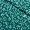 Ткань с густыми белыми снежинками на зеленом фоне, ширина 160 см