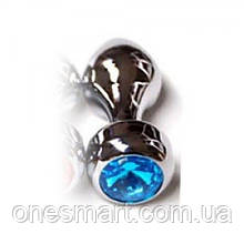 Срібляста анальна пробка з блакитним дорогоцінним каменем