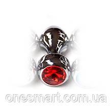 Срібляста анальна пробка з червоним дорогоцінним каменем