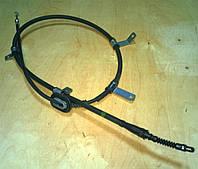 Трос ручника левый KIA Carens 59760-1D000