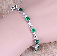 Женский серебряный браслет зеленый изумруд, топаз, фото 1