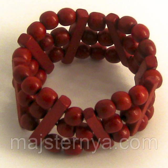 Браслет з дерев'яних намистин червоного кольору в три ряди