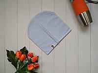 Демисезонная трикотажная шапка для девочки подростка Bape Kids голубого цвета