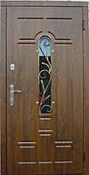 Двери входные с стеклопакетом и ковкой