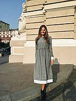 Стильное платье длины миди.