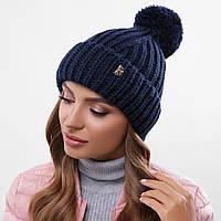 Темно-синя шапка з помпоном