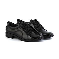 Туфли черного цвета на низком каблуке на шнуровке