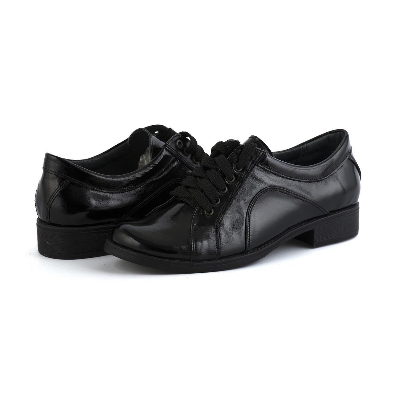 Лаковые туфли черного цвета на низком каблуке