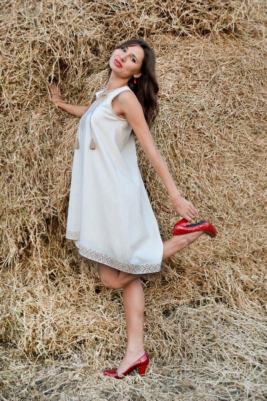 Расклешенное платье с американской проймой