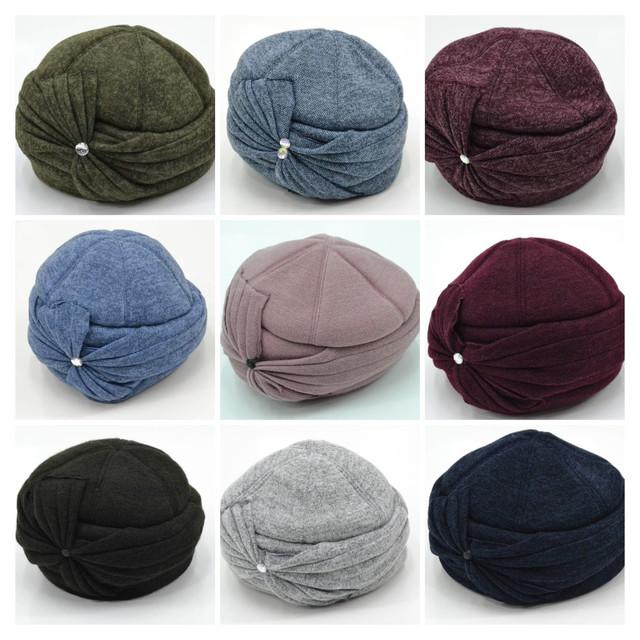 Женские шерстяные шапки