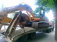 Перевозка экскаватора бульдозера в Украине
