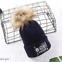 Теплая шапка для мальчика синяя с коричневым помпоном