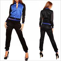 Черно-синий спортивный костюм женский, Модель оформлена синими вставками и втачными карманами