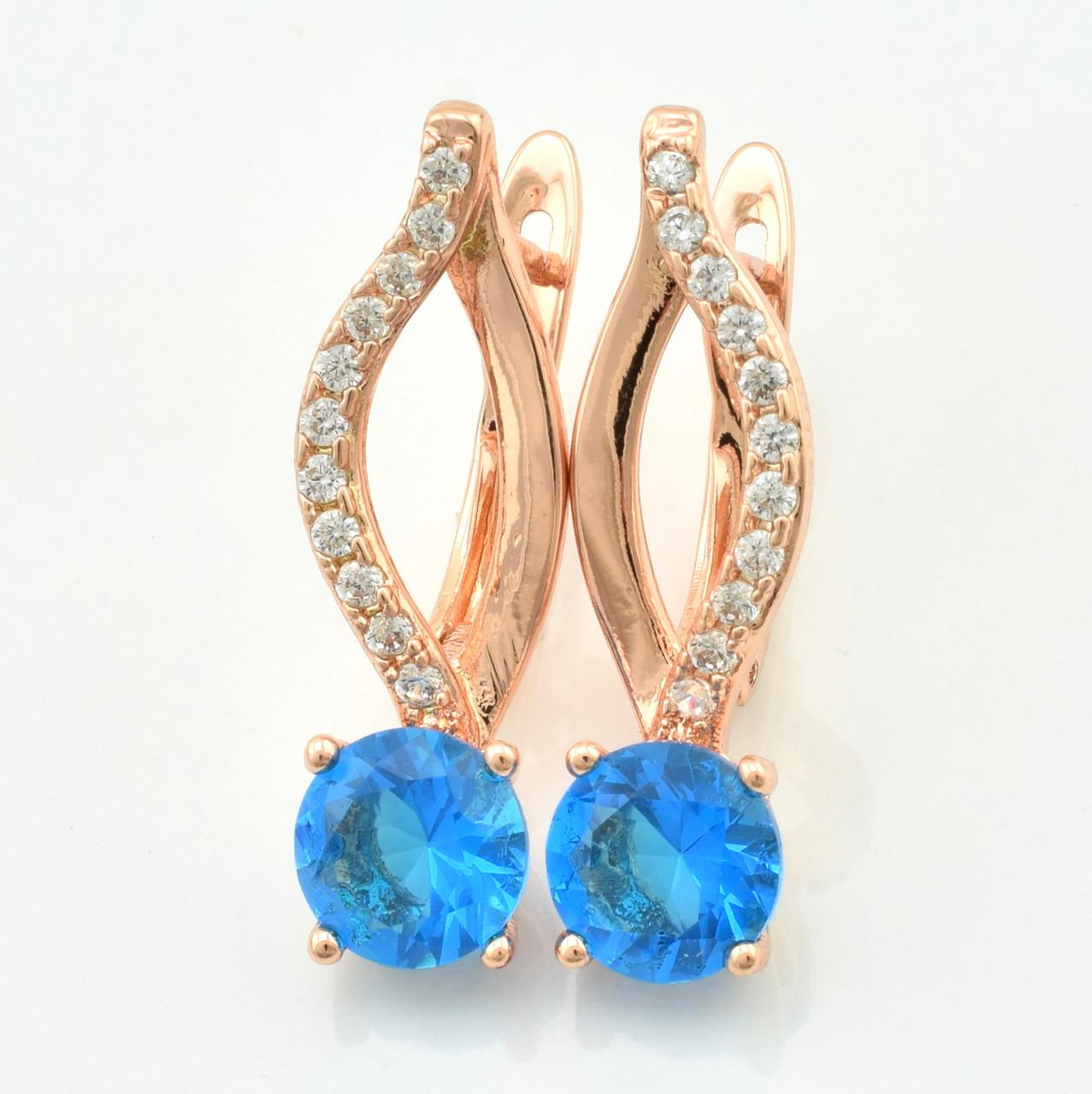 Серьги 21569, размер 25*7 мм, голубые фианиты, позолота РО