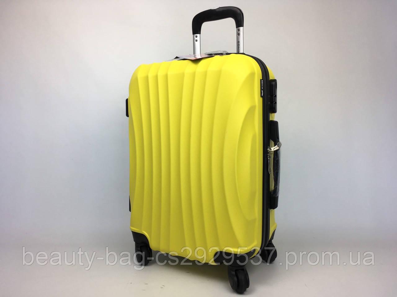 Чемодан пластиковый среднего размера Wings 159 Midi желтый