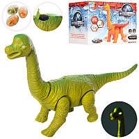 Динозавр 9789-78 JW, 43см, ходит, несет яйца, проектор, звук, подвижные детали, свет