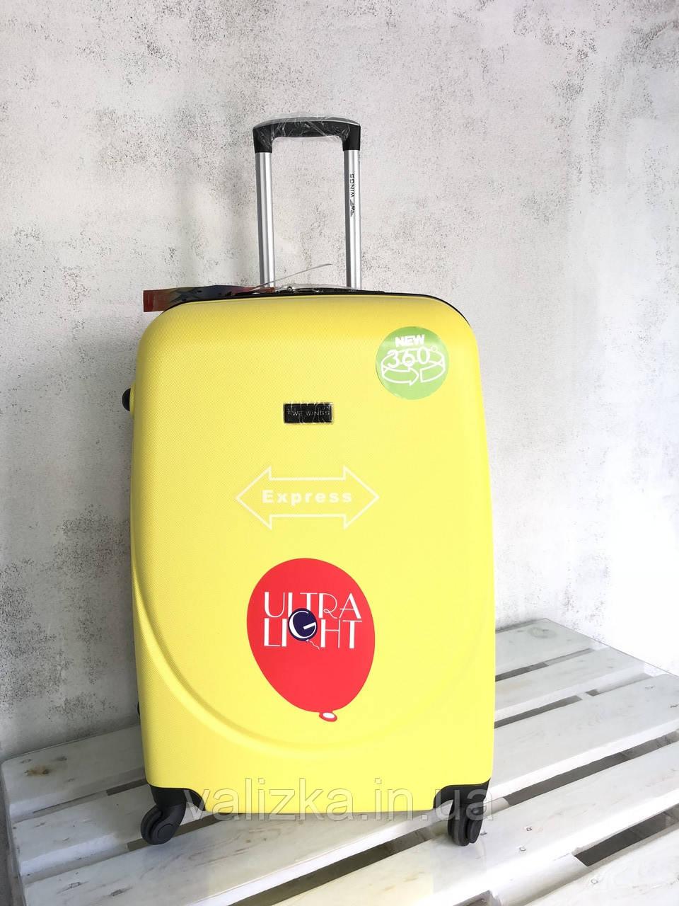 WINGS / Большой пластиковый чемодан на 4-х колесах желтый / Велика пластикова валіза на колесах жовта Польша