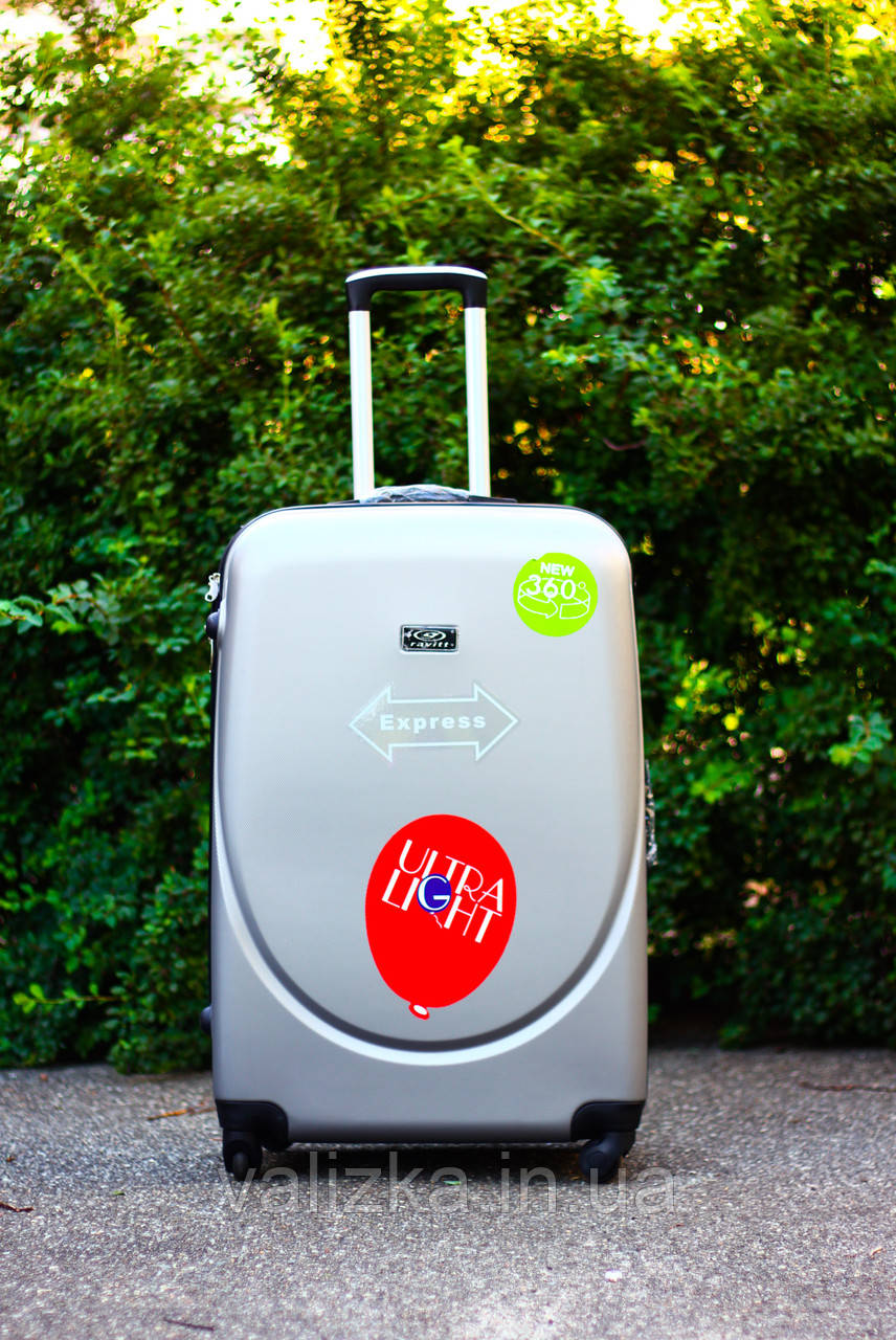 Большой пластиковый чемодан на 4-х колесах серебро / Велика пластикова валіза на колесах срібна Польша