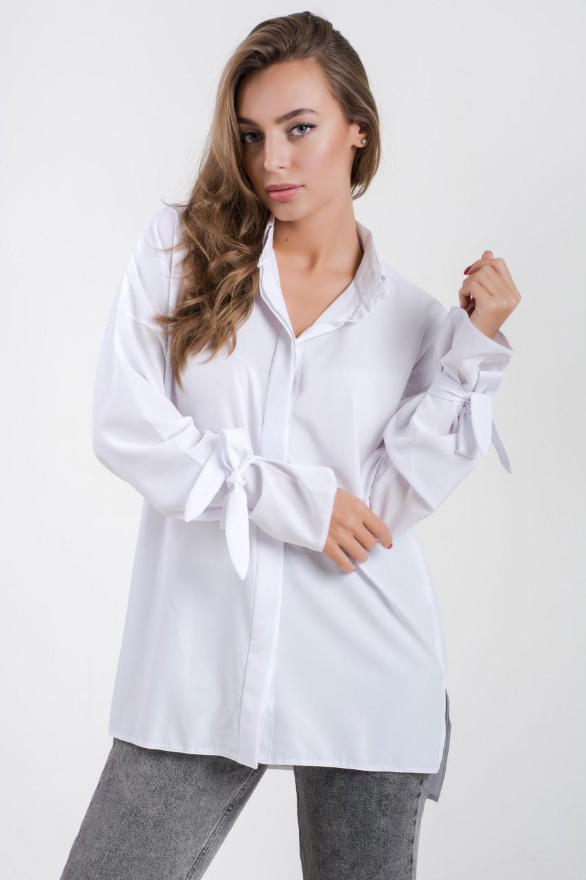 Стильная женская блуза  свободного кроя  с завязками на рукавах