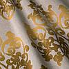Ткань для штор с золотым вензелем на бежевом фоне