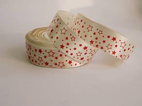 Стрічка атласна з червоними зірками 2,5см молочна