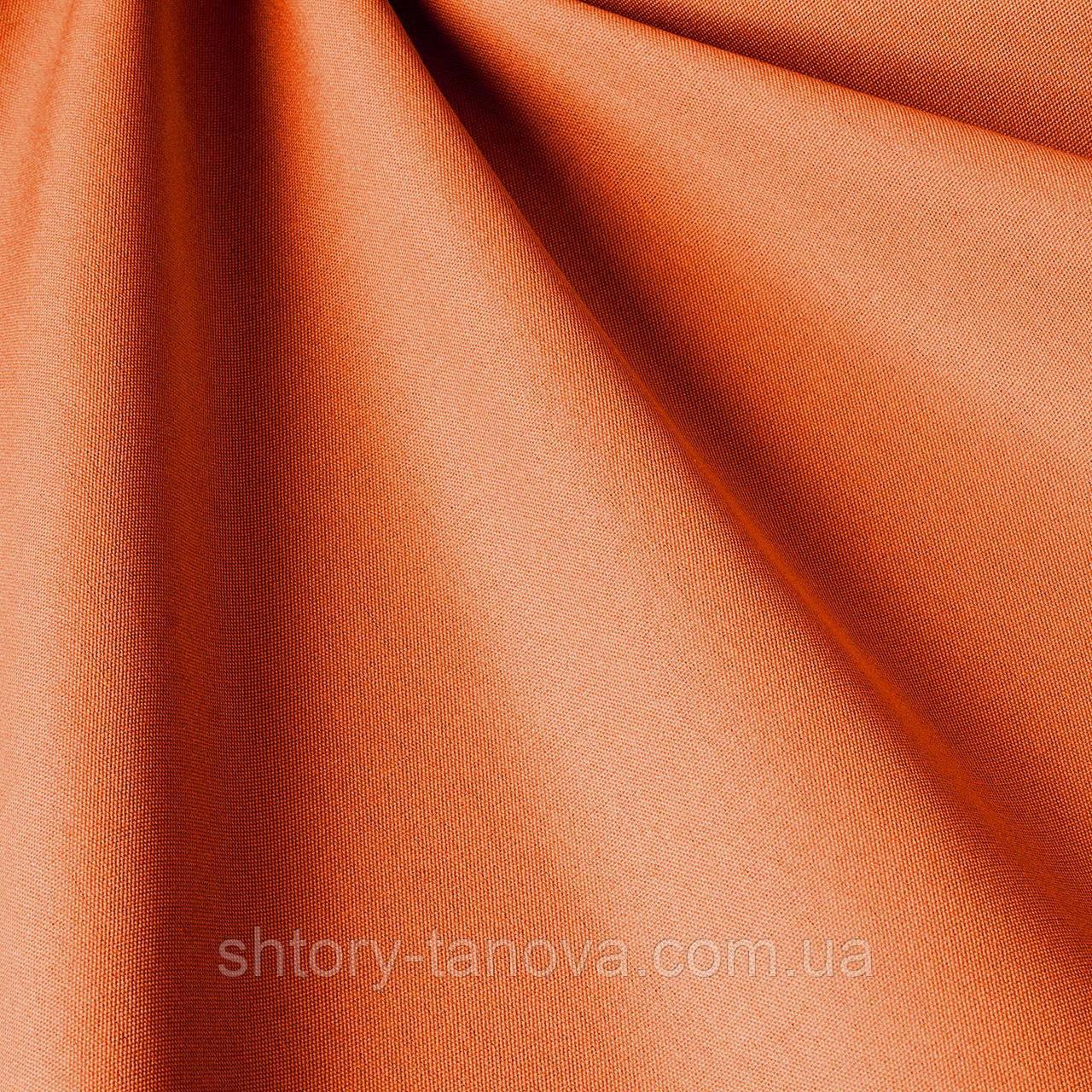 Однотонна вулична тканина морквяного кольору