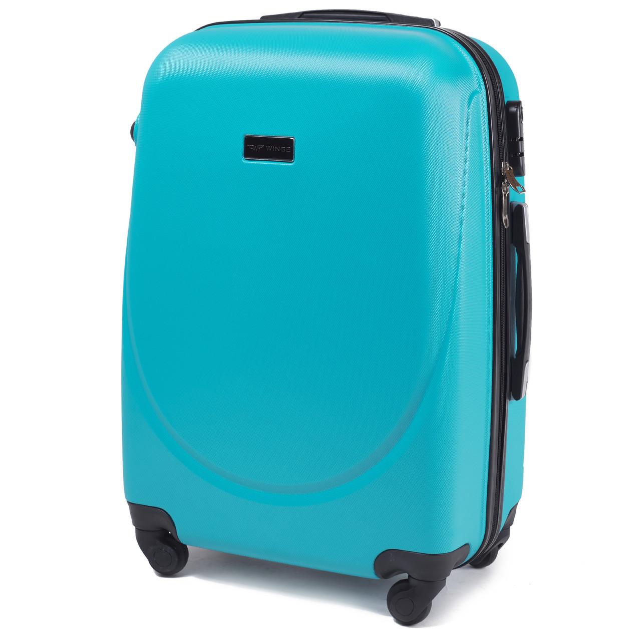 Большой пластиковый чемодан Wings 310 на 4 колесах голубой