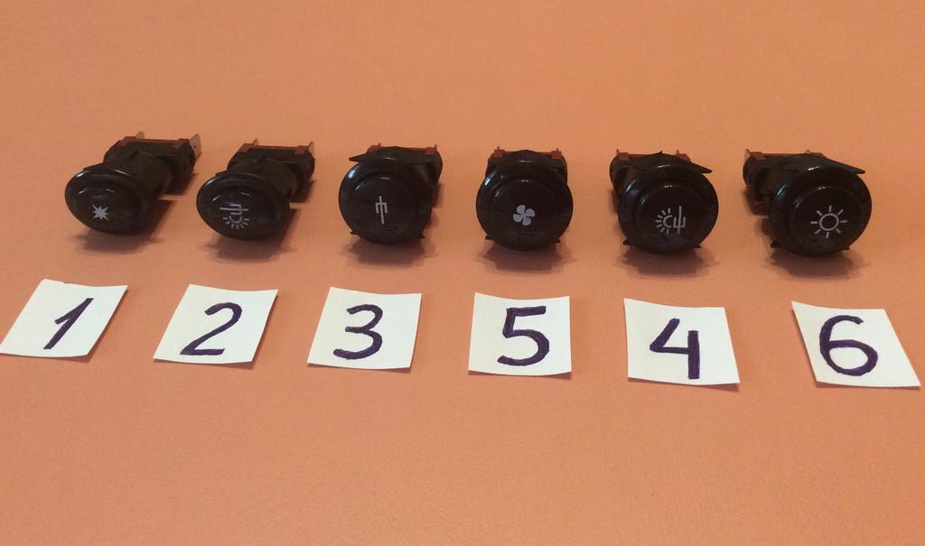 Кнопки для включения разных режимов в газовых плитах / черные