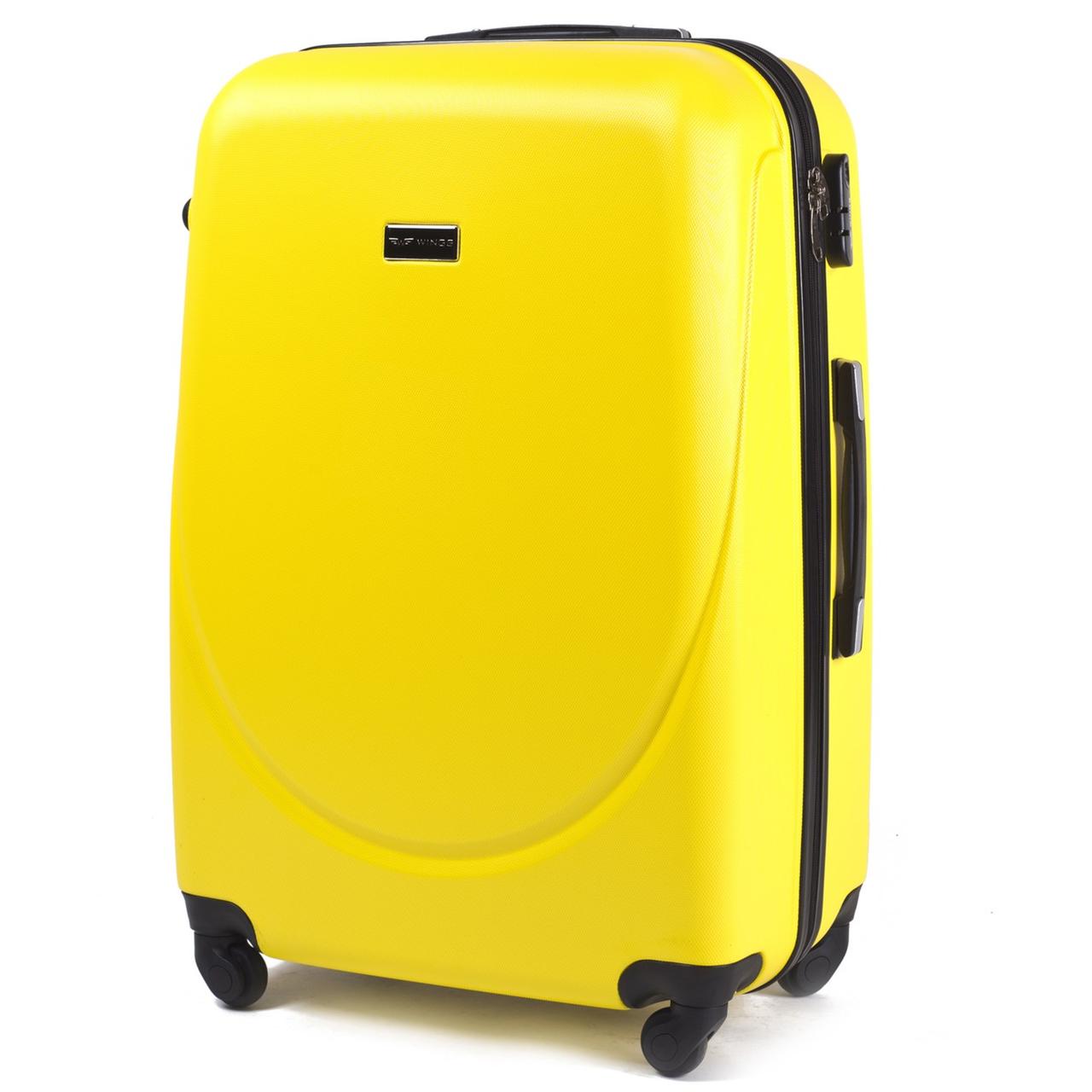 Средний пластиковый чемодан Wings 310 на 4 колесах желтый