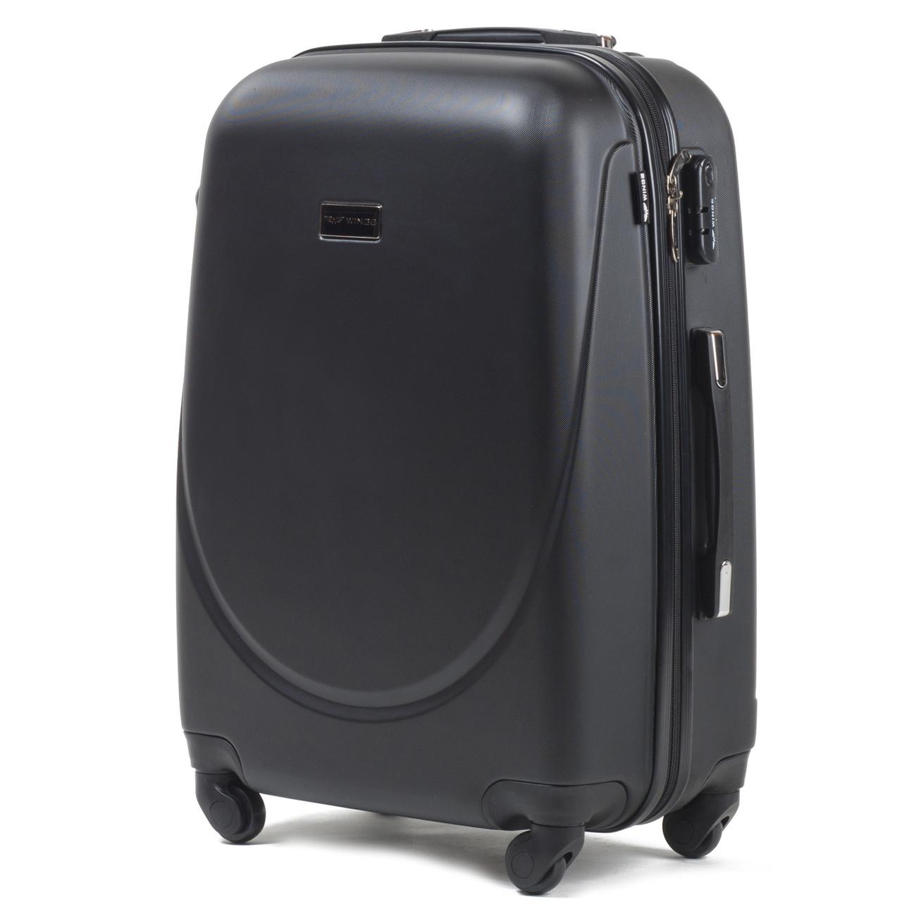 Средний пластиковый чемодан Wings 310 на 4 колесах черный