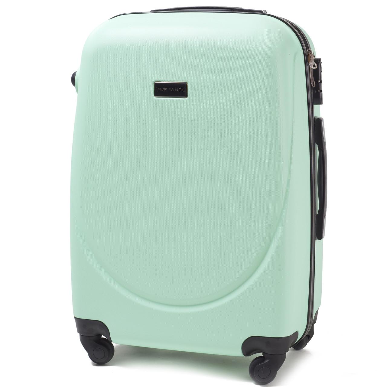 Средний пластиковый чемодан Wings 310 на 4 колесах зеленый
