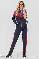Теплый трехцветный спортивный костюм темно-синего цвета