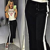 Модные брюки спортивного типа полоскасбоку