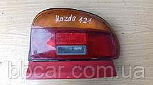 Задний фонарь  Mazda 121 sedan Koito 33-095-05  ( L )