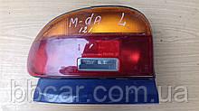 Задний фонарь  Mazda 121 sedan Koito 33-095-05  ( R )