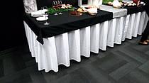 Фуршетная юбка с широкими пробелами между бантовыми складками. Расход 1:1,8 ткани. Стандартной высоты 1-2см от пола.