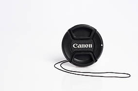 Крышка на объектив с надписью Canon 49 mm