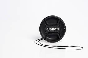 Крышка на объектив с надписью Canon 49mm