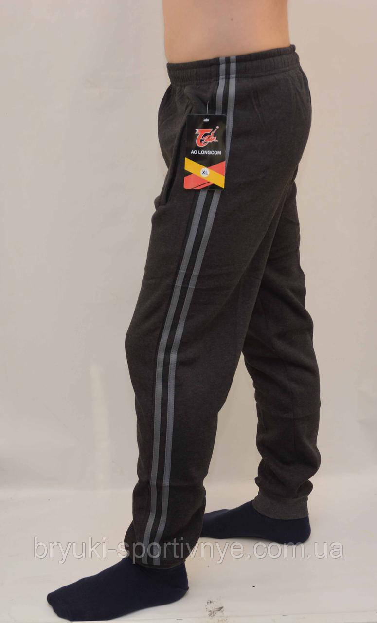 Брюки мужские зимние спортивные под манжет с 2 полосами и карманами на молнии