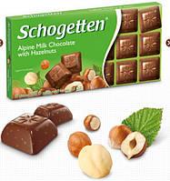 Шоколад Schogetten Milk chocolate with hazelnuts Молочный с лесными орехами 100г