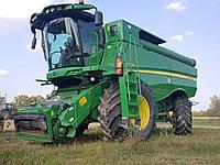 Зерноуборочный комбайн John Deere S680i 2013 года, фото 1