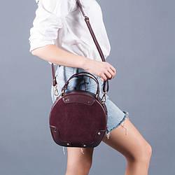 Женская сумочка из натуральной кожи и замши в цвете бордо.