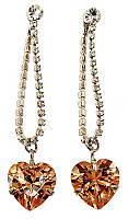 Серьги -гвоздики со стразами и жёлтыми цирконами. Цвет серебряный.Длина серьги: 5.5 см. Ширина: 12 мм.